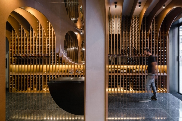 A Curved Display Of Bottles The Lavinia Wine In Paris